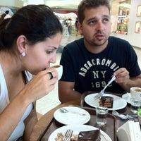 Photo taken at O Melhor Bolo de Chocolate do Mundo by Ligia D. on 4/15/2012