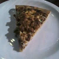 Photo taken at Super Pizza Pan by Minoru M. on 7/2/2012