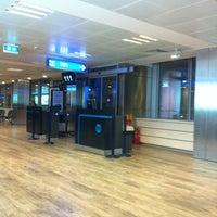Photo taken at Gate 111 by Taygun B. on 5/27/2012