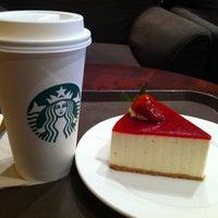 Photo taken at Starbucks by Yulia F. on 3/19/2012
