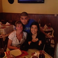 Photo taken at Espana Tapas Wine Bar by Rebecca G. on 5/13/2012