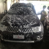 Photo taken at Miracle Car Wash by gilbert c. on 7/6/2012
