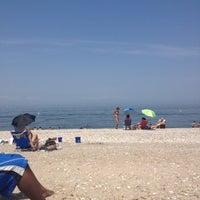 Photo taken at Cedar Beach by Crystal B. on 5/28/2012