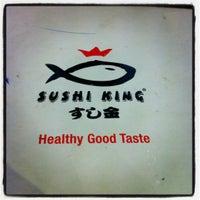 Photo taken at Sushi King by Muhammad N. on 8/4/2012