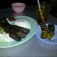Photo taken at Seafood Lesehan Mbak Imah by pip k. on 9/13/2012