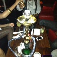 Photo taken at Gazuza Lounge by Sheniaka R. on 4/15/2012