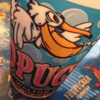 Photo taken at Fudpuckers Beachside Bar & Grill by Jim C. on 5/26/2012