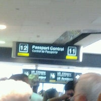 Photo taken at US Customs & Immigration by Kimberly E. on 6/27/2012