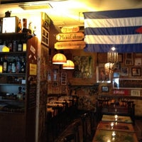 Photo taken at La Bodeguita del Medio by Roberto M. on 6/14/2012