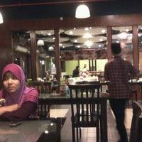 Photo taken at Restoran Simpang Tiga by Nurul Nazwa S. on 10/22/2011