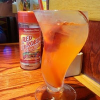 Photo taken at Red Robin Gourmet Burgers by Amanda H. on 8/25/2012