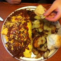 Photo taken at Broken Yolk Cafe by Nathan K. on 12/29/2011