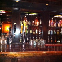 Photo taken at Madra Rua Irish Pub by Matt K. on 7/29/2011
