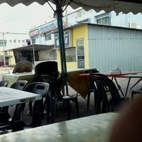 Photo taken at Uptown Parit Raja by Hamid Y. on 2/15/2012
