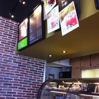 Photo taken at Starbucks by Catalina V. on 8/24/2011