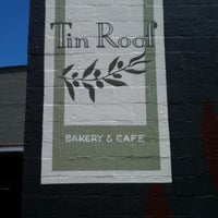 Photo taken at Tin Roof Bakery by Nathan on 6/27/2012