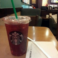 Photo taken at Starbucks Coffee by Paolo B. on 3/28/2012
