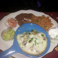 Photo taken at Carlos' Cantina by Ian W. on 3/31/2012