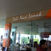 Photo taken at Deli Nasi Lemak by Chermaine L. on 3/28/2011