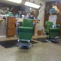 Photo taken at Buck's Barber Shop by Anthony B. on 12/29/2011