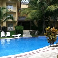 Photo taken at Dreams Punta Cana Resort and Spa by Mello W. on 12/19/2011