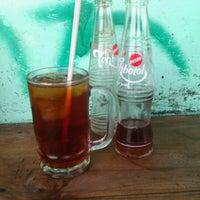 Photo taken at Warung Sate Btulan by Komang R. on 12/7/2011