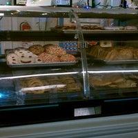 Photo taken at El Salvador Bakery by Lyndsey C. on 12/21/2011