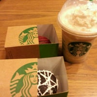 Photo taken at Starbucks by Danica camille T. on 12/15/2011
