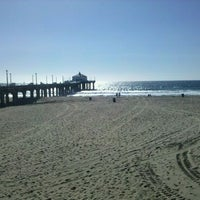 Photo taken at Manhattan Beach by Alan H. on 10/6/2011