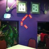 Photo taken at Khatulistiwa Restaurant & Cafe by Dennis L. on 2/3/2011