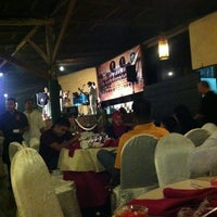 Photo taken at The Gayam Seafood Barbeque & Bar by abby r. on 7/17/2012