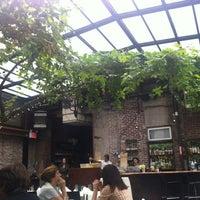 Photo taken at Revel Restaurant and Garden by Amanda K. on 4/22/2012
