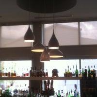 Photo taken at Seed Kitchen & Bar by Chris C. on 7/23/2012