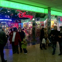 Photo taken at Disney Store by Ginger G. on 1/8/2012