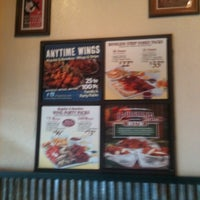Photo taken at Wingstop by Gill N. on 11/22/2011
