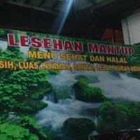 Photo taken at Lesehan Mantup by Teguh Kurniawan H. on 12/26/2011