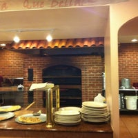 Photo taken at Oaks Italian Pizzeria & Deli by Carolynn B. on 6/13/2011