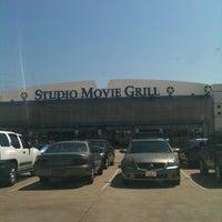 Photo taken at Studio Movie Grill by Adarius M. on 8/7/2011