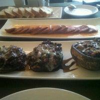 Photo taken at El Olivo Restaurante by Ivy J. on 1/13/2012
