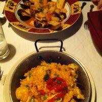 Photo taken at Tasca Spanish Tapas Restaurant & Bar by Krystle J. on 3/21/2011