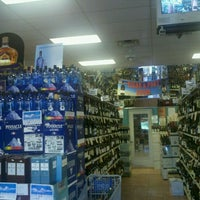 Photo taken at Norman's Liquor & Fine Wines by Kat M. on 8/21/2011