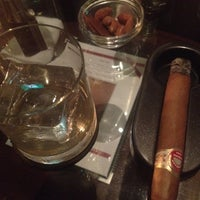 Photo taken at le connaissur CIGAR BAR by Serhat G. on 3/31/2012