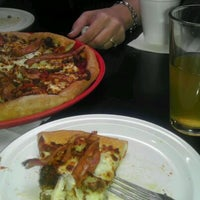 Photo taken at Minsky's Pizza by Jeff B. on 1/30/2012