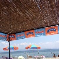 Photo taken at Raca Beach Club by Ersen B. on 8/4/2012