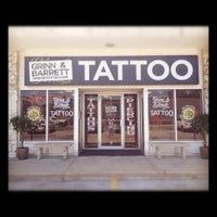 Photo taken at Grinn and Barrett Tattoo Studio by Jen B. on 6/13/2012