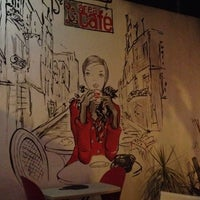 Photo taken at Área Café by Eva P. on 3/27/2012