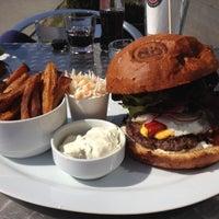 Photo taken at Domyno Burger Bar by David on 4/4/2012