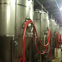 Photo taken at DC Brau Brewing Co by Josie K. on 9/8/2012