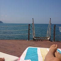 Photo taken at İnkum Terrace by Fatma K. on 8/4/2012