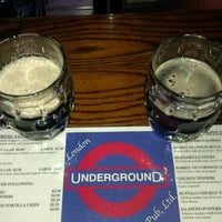 Photo taken at London Underground Pub by Tommi on 2/12/2012